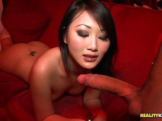 Regimen chinese filly in knee highs takes wood from the back in public