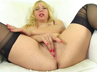 Zesty mature blonde with big tits opens her legs for sexy solo pleasure