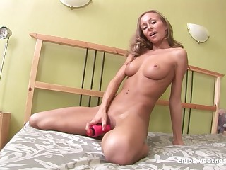 Solo blonde model Amely B poking her cunt and fingering her butt